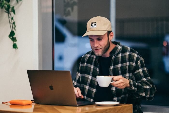 man at coffee house with laptop creative writing Exercises
