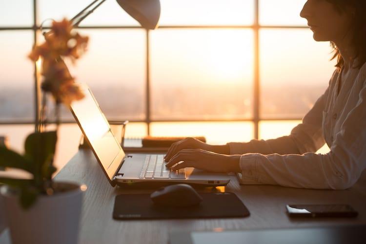 woman typing choose a pen name