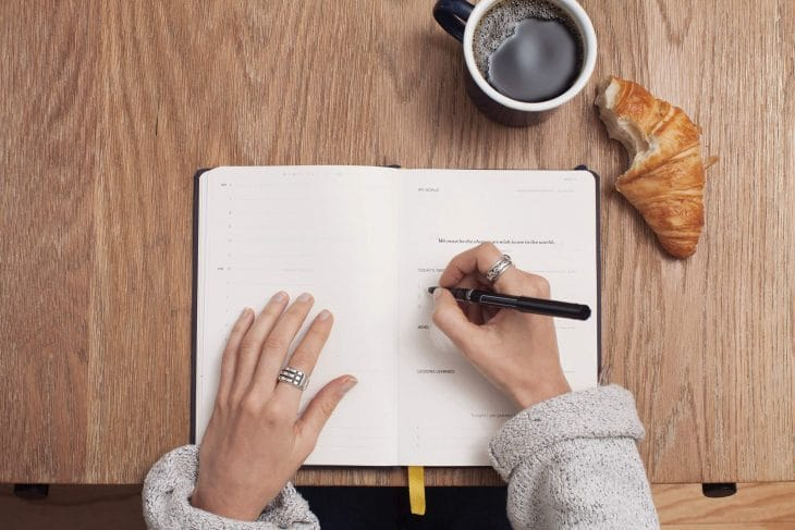 woman writing, journal prompts